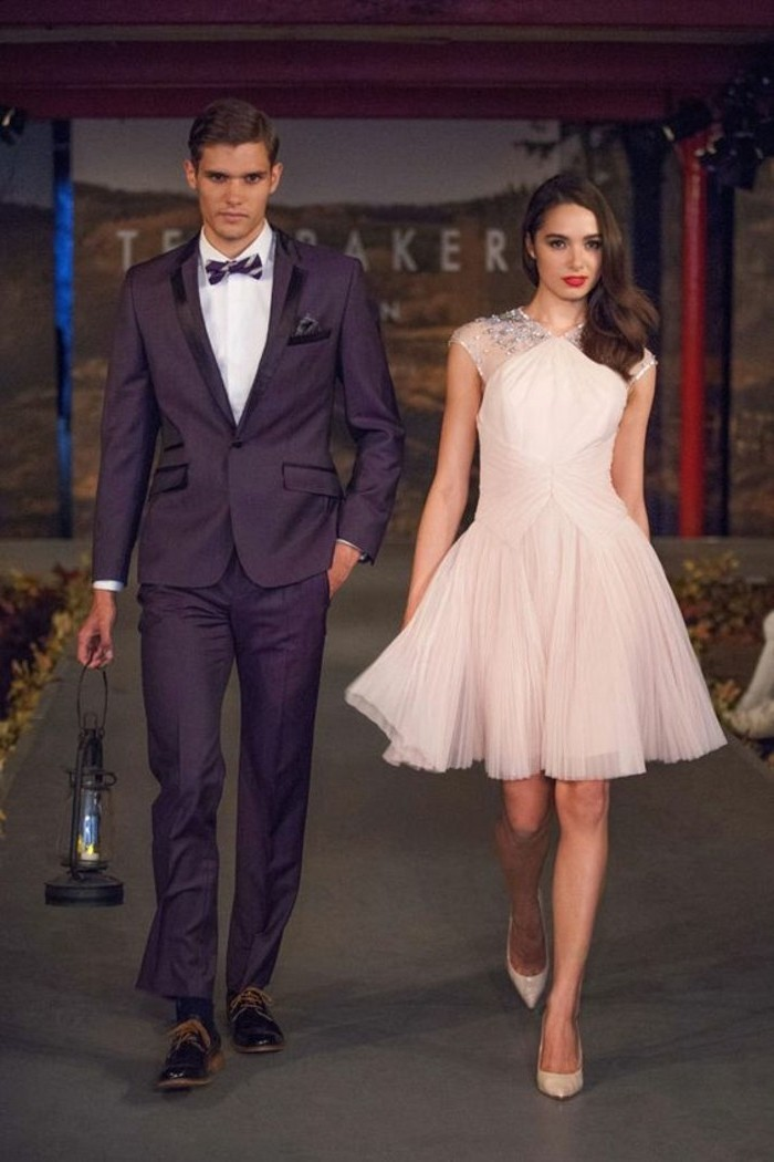floaty pale pink dress, with tulle skirt and sequin details, worn b y brunette woman, walking next to man in black tuxedo, mens summer wedding attire, white shirt and bowtie