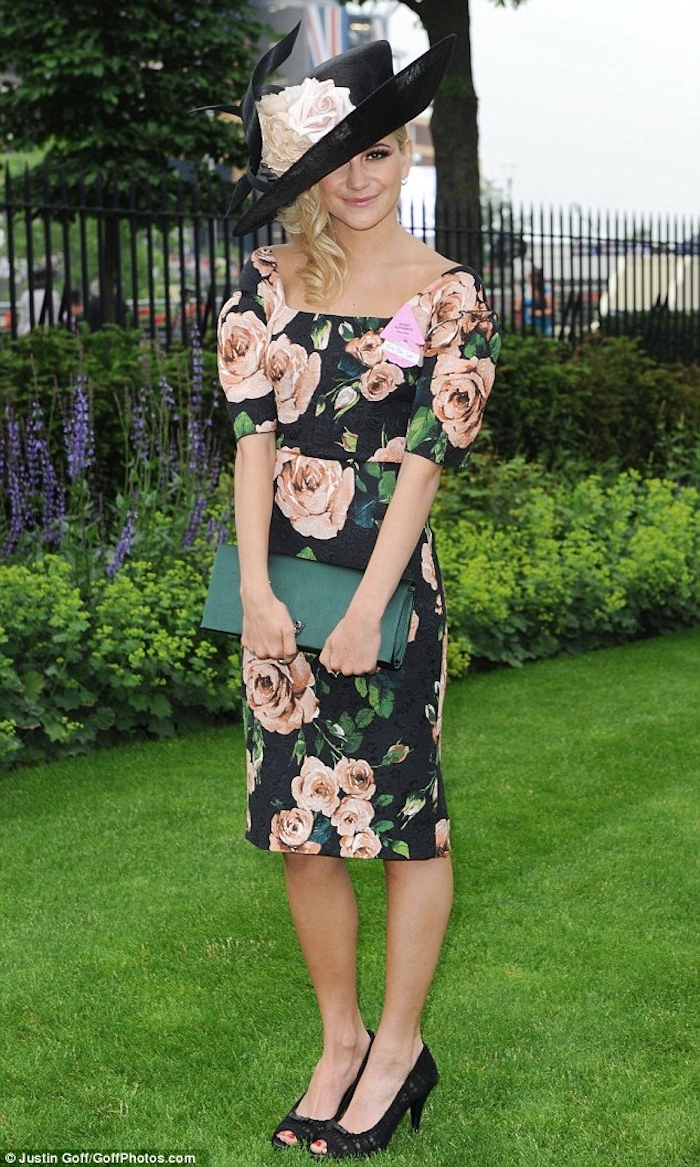 black knee-length dress, with pale pink and green rose pattern, worn by smiling young blonde woman, garden party attire, fancy black hat with roses, black peep toe heels