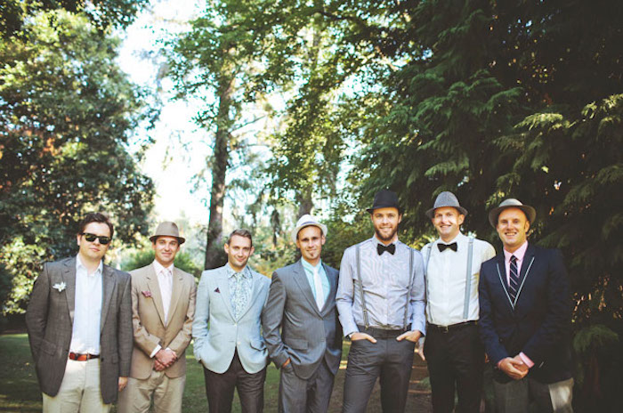 seven men in casually elegant clothes, what is semi formal attire, blazers and shirts, suspenders and bow ties, hats and sunglasses