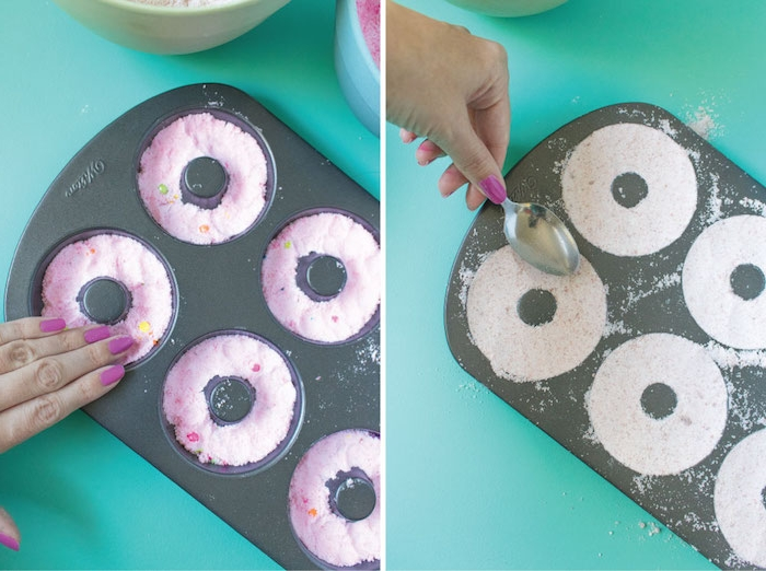 pressing white powder, into black teflon donut mould, using a metal spoon, making bath bombs, smoothing pink powder on top