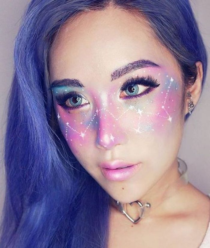 cute makeup looks, or body art ideas, space painted in pink and blue, with constellations and stars in white, on the face of a young girl, with pearly pink lipstick, and violet hair