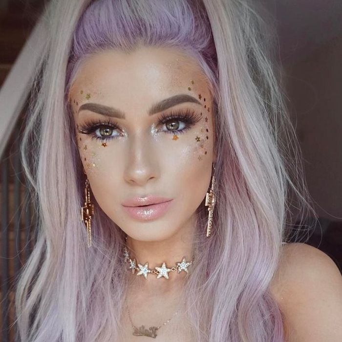 pearly glossy pale pink lipstick, worn by young woman with fake lashes, big chunky earrings, pale pink and blonde hair, cute makeup looks, many tiny gold and silver star stickers on her cheek
