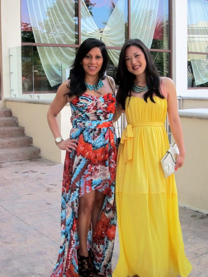 multicolored asymmetrical maxi dress, worn with black lace up sandals, and turquoise chunky necklace, what is semi formal attire, floaty yellow gown