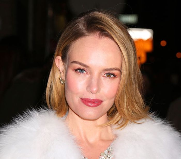 smooth hair with side part, worn tucked behind one ear, and falling over the other, easy short hairstyles, smiling woman in a fluffy, white fur coat