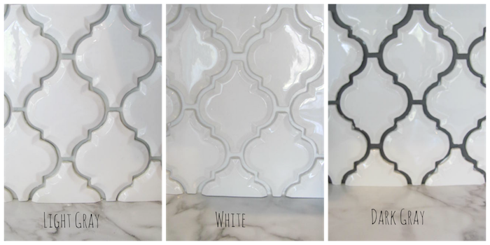 three examples of a white, arabesque tile backsplash, with joints in light grey, white or dark grey, near a smooth marble surface