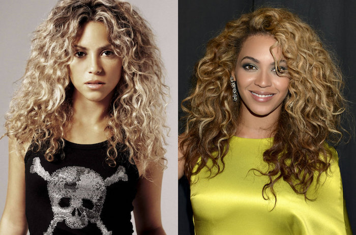 cute easy hairstyles, shakira and beyonce, dressed in a black tank top, with a skull and bones, and a silky yellow blouse, and wearing similar, blonde curly hairstyles