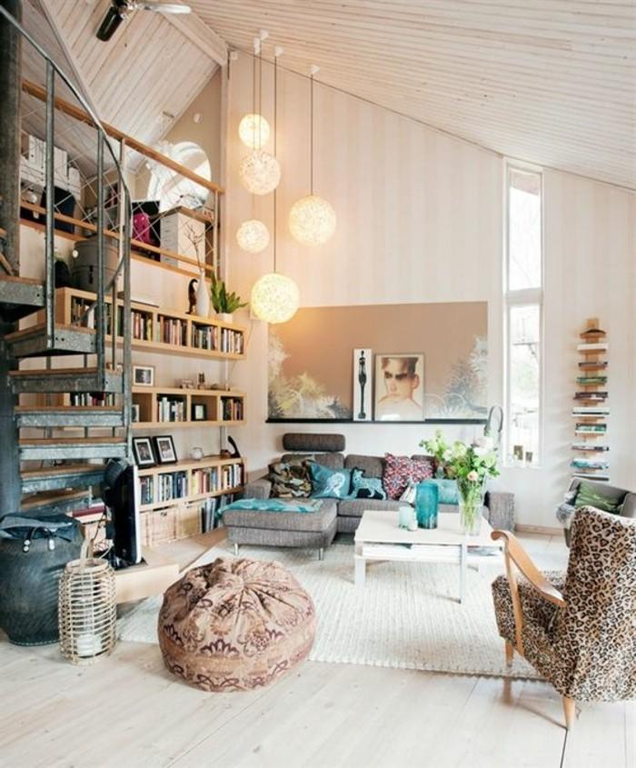 animal print armchair, and a grey corner sofa, inside a loft studio, home decor inspiration, pale beige walls, and a cream laminate floor