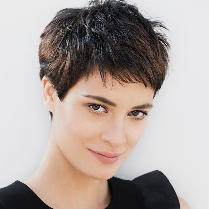 boyish-style dark brunette, extremely short and shaggy pixie cut, with cropped bangs, short haircuts for thin hair, worn by young smiling woman