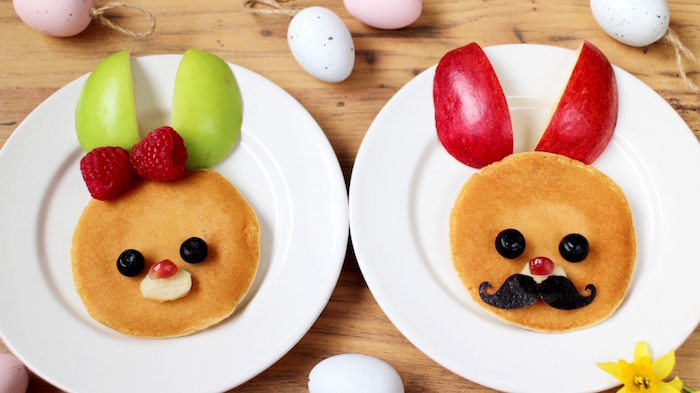pancakes decorated with fresh fruit, and made to look like bunny faces, simple breakfast ideas, green and red apple slices, blueberries and banana slices, raspberries and pomegranate seeds