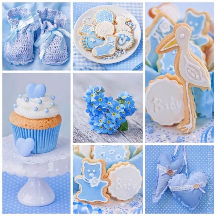 cookies decorated with pale blue and white frosting, little knitted baby booties in light lavender, forget-me-nots and a cupcake