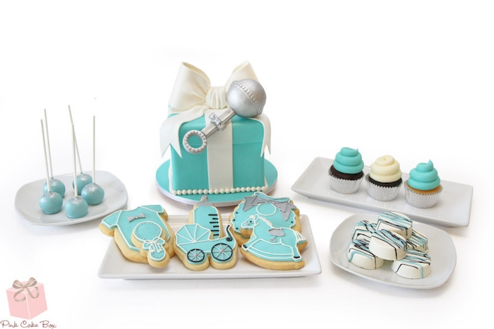 turquoise and white cake, shaped like a present with a fondant bow, cookies shaped like various baby-related items, baby shower cakes for boys, cupcakes and cake pops