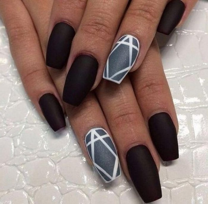 velvet-like black matte coffin nails, with a grey ring-finger nail, decorated with a white diamond-shape, a white outline and stripe