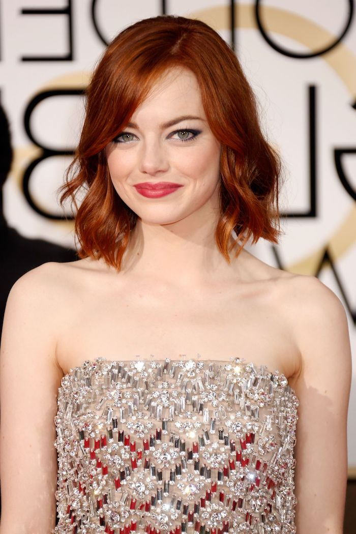 fiery red or ginger hair, shaped in a long bob, with side bangs and waves, short hairstyles for fine hair, on emma stone, smiling in a sequined silver dress
