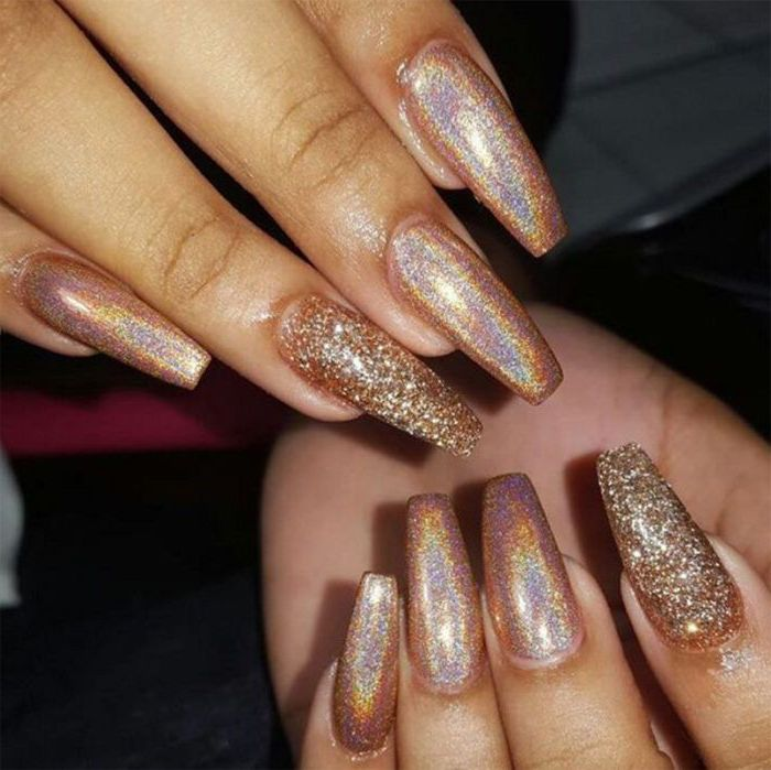 glistening long nude coffin nails, with iridescent effect, two of the nails are covered in rough, glitter flakes in gold