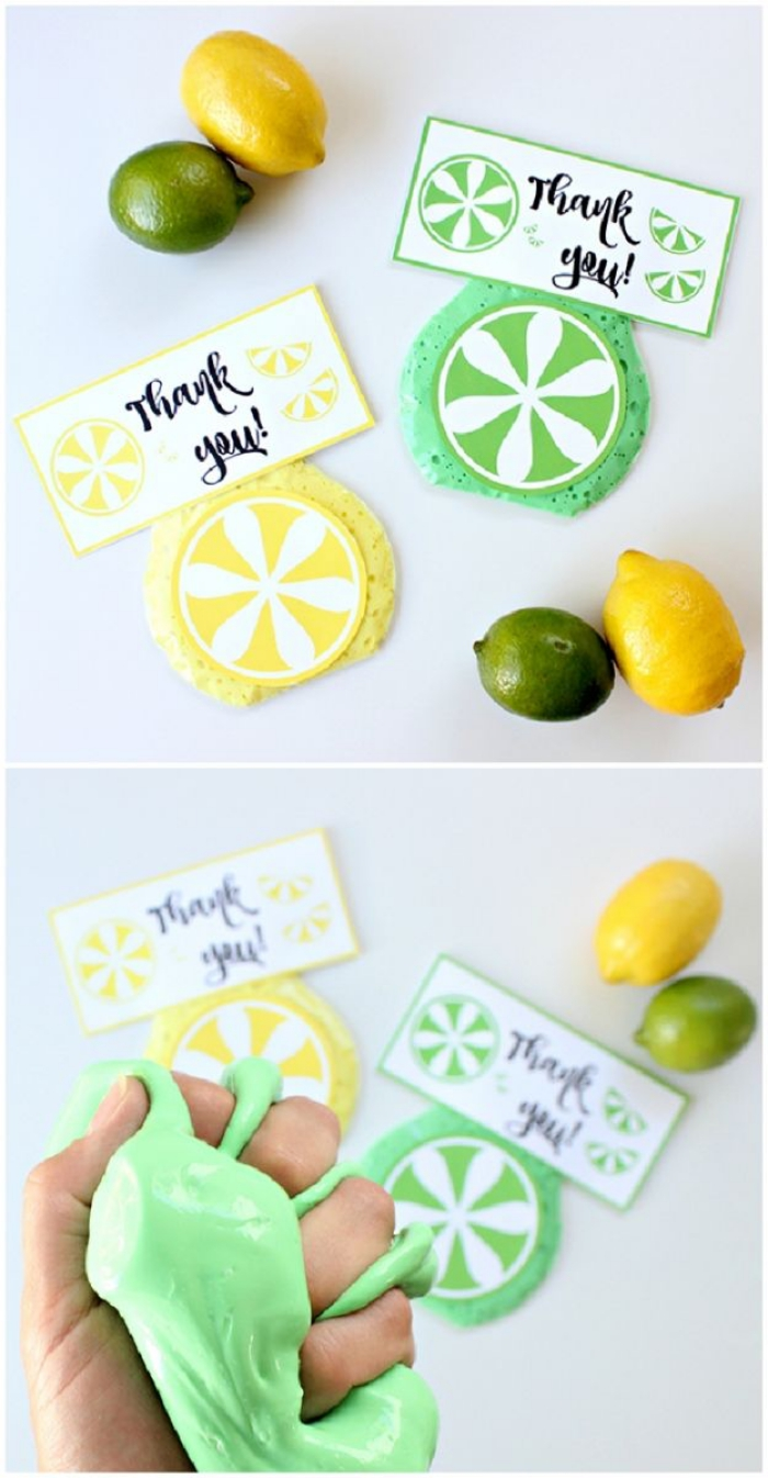lemons and limes, and two thank you notes, in yellow and green, placed near two round pieces of slime, decorated like citrus fruit, hand squeezing fluffy green slime