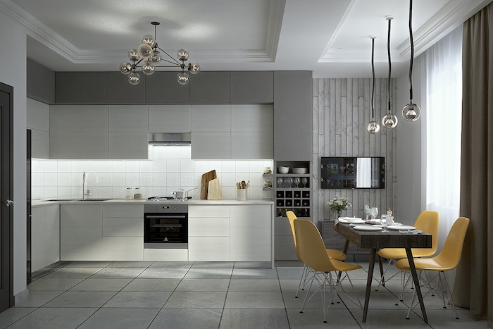 white kitchen backsplash, with square tiles, in a spacious room, with a dark brown table, and four yellow chairs, grey and white cabinets
