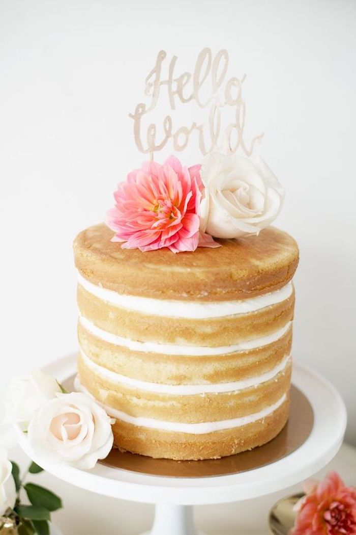 hello world written in white, baby shower cake toppers girl, on top of a five-layered cake, decorated with fresh flowers, in pink and white
