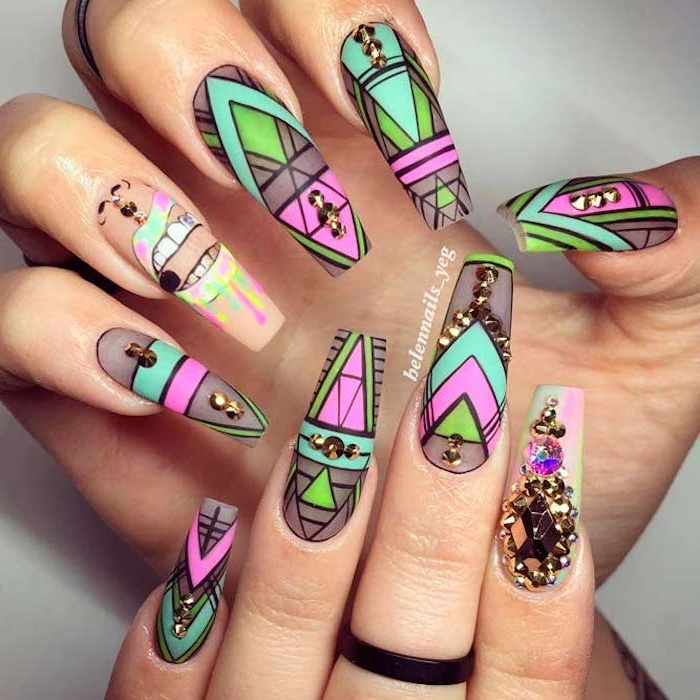 symmetrical geometric shapes, and a drawing, with black outlines, and neon colors, painted on long, clear fake nails, attached to two hands