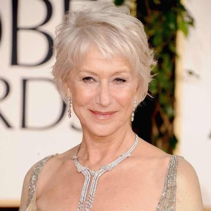 silver wavy pixie cut, with messy bangs, worn by helen mirren, with a encrusted silver necklace, and a strappy embroidered top, hairstyles for women with thin hair