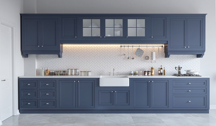 slate blue kitchen cabinets, in a room with marble tile floor, white counter tops, white kitchen backsplash, and various utensils