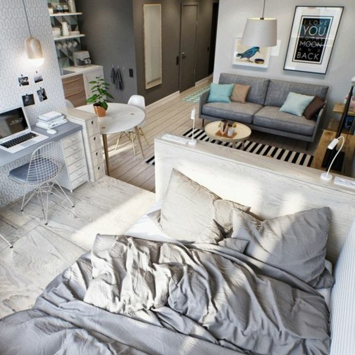 desk in light grey and white, with a matching chair, near a bed in creamy grey, room design, small grey sofa, and a coffee table