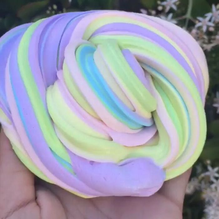 foamy multicolored twisted piece of goo, in soft pastel colors, how to make fluffy slime, pale yellow and green, baby blue and pink, with light purple