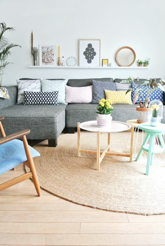 simple living room designs, bauhaus furniture inside a room, with duck's egg blue wall, grey corner sofa, with multicolored cushions, coffee tables and chairs
