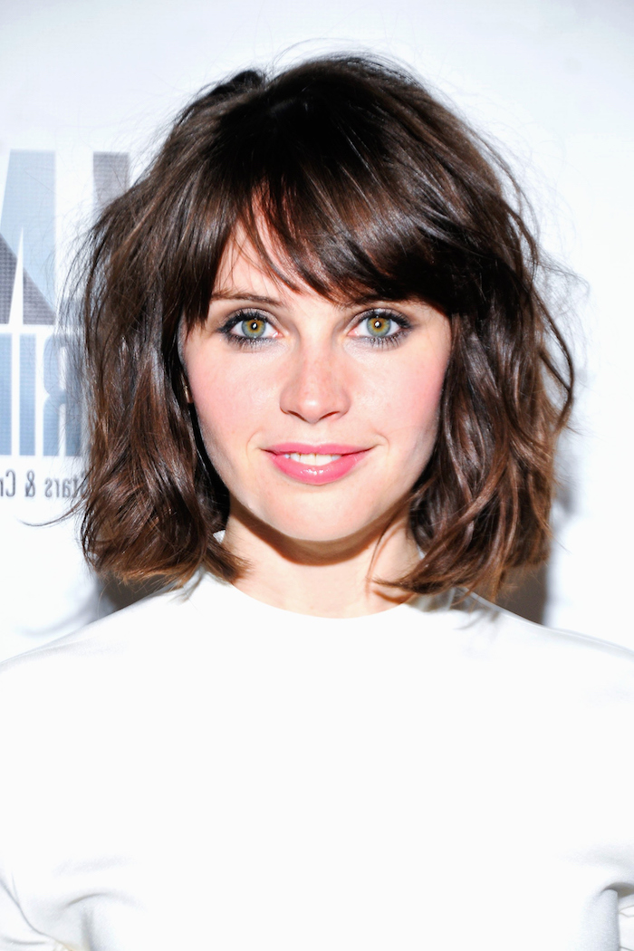 hazel green eyes, and messy brunette hair, in a long bob with shaggy bangs, smiling young woman in a white t-shirt, medium length hairstyles for thin hair