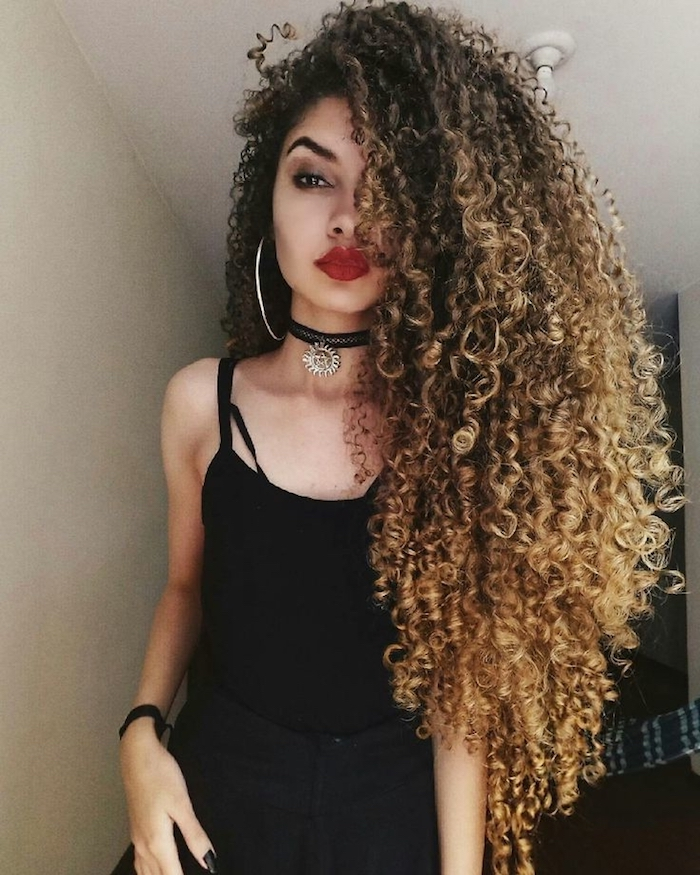 choker necklaces in black, and a black strappy top, worn by young woman, with bright red lipstick, and very long ombre hair, long curly hairstyles, large hoop earring