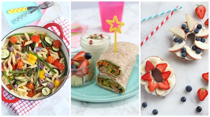 wraps with vegetables, bagels with cream cheese, strawberries and bananas, apples and blueberries, and a pan of pasta with vegetables