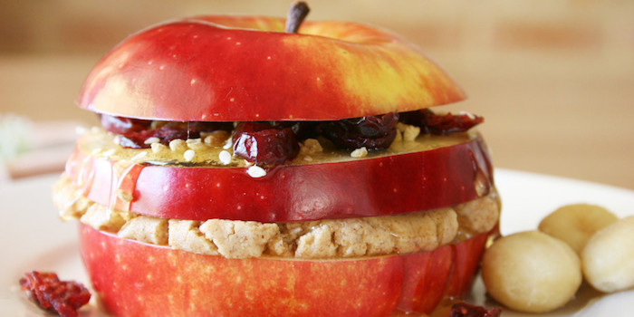 simple breakfast ideas, sliced red apple, with stuffing between the slices, honey seeds and raisins, mushy beige oatmeal