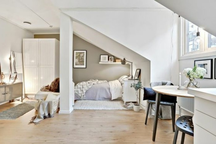 home decor inspiration, white wardrobe and a bed in light colors, pale beige laminate floor, small table with two dark chairs