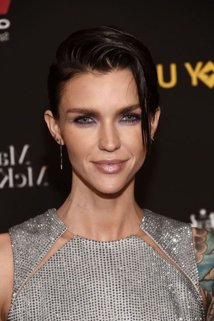 glittering silver sleeveless top, with cutout details, worn by ruby rose, dark eye make up, hairstyles for fine thin hair, wet-look pixie cut, swept over to one side