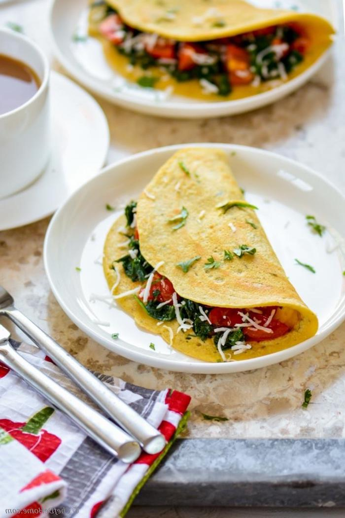 omelettes stuffed with fresh vegetables, cherry tomato and spinach, and dusted with parsley and grated cheese, what is a healthy breakfast, cup of tea nearby