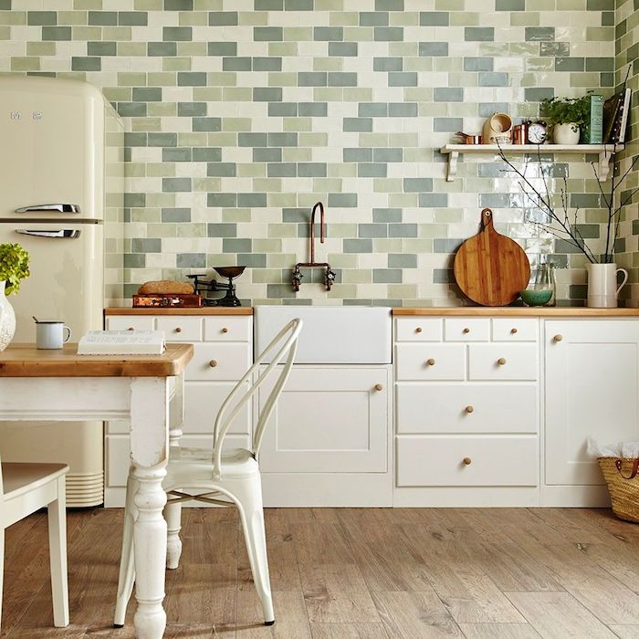 green in different shades, on a subway tile kitchen backsplash, inside a kitchen with a vintage fridge, and white cabinets