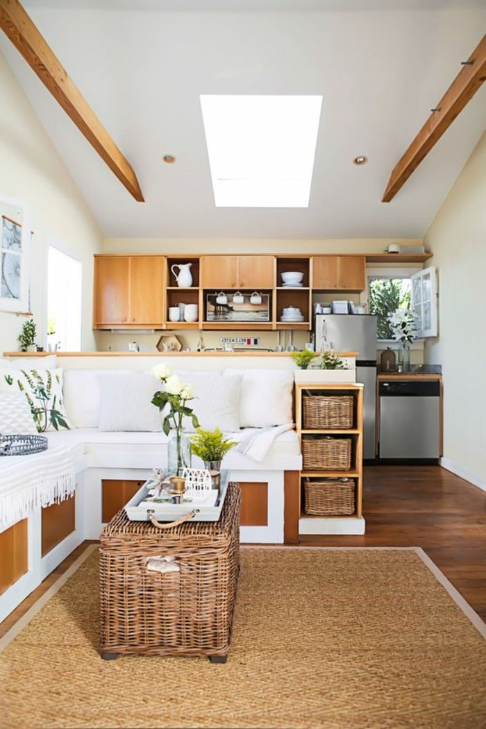 wicker furniture details, and wooden cabinets, inside a room with a kitchenette, and a living room area, home decor inspiration, brown and white palette