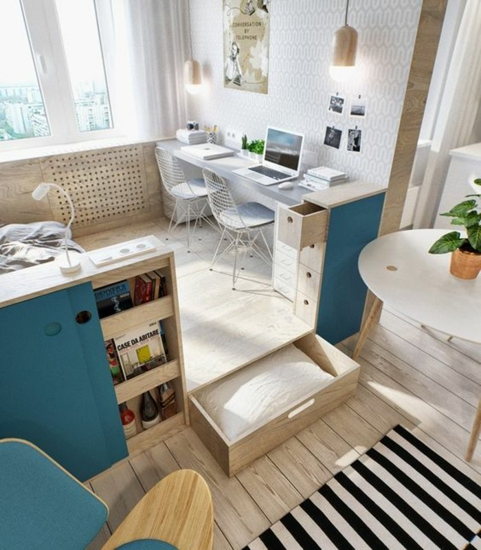 storage spaces and drawers, inside a bright room, with light beige wooden floor, living room furniture for small spaces, furniture with teal accents, grey desk with two chairs