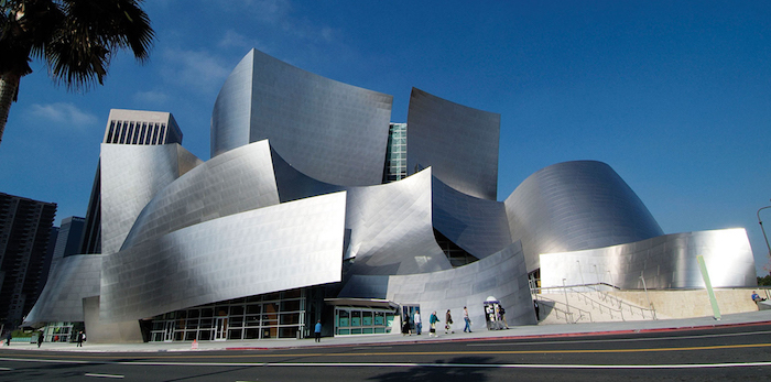 silver-colored building, comprised by several abstract shapes, resembling welded metal, postmodernism characteristics, the walt disney concert hall in los angeles