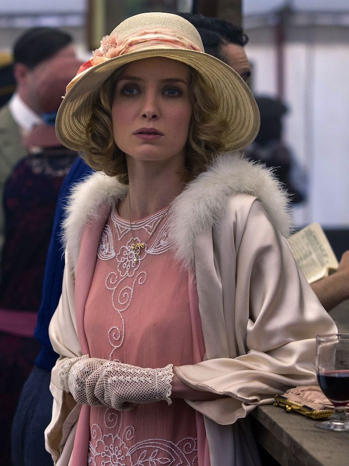 peach pink flapper dress, embroidered with white beads, worn with a cream satin coat, featuring a white lace trim, and crochet lace gloves, great gatsby outfits, annabelle wallis in peaky blinders