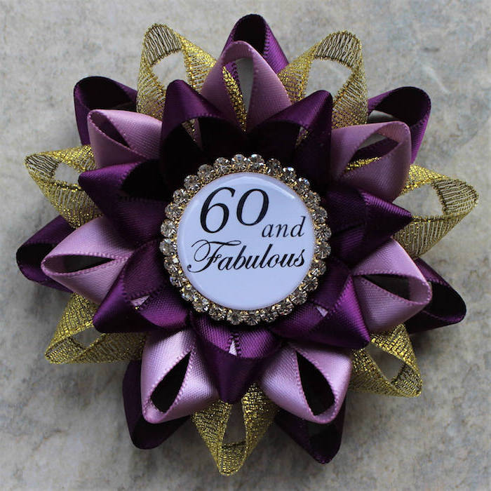brooch made from purple, pink and gold mesh ribbons, with a badge reading 60 and fabulous