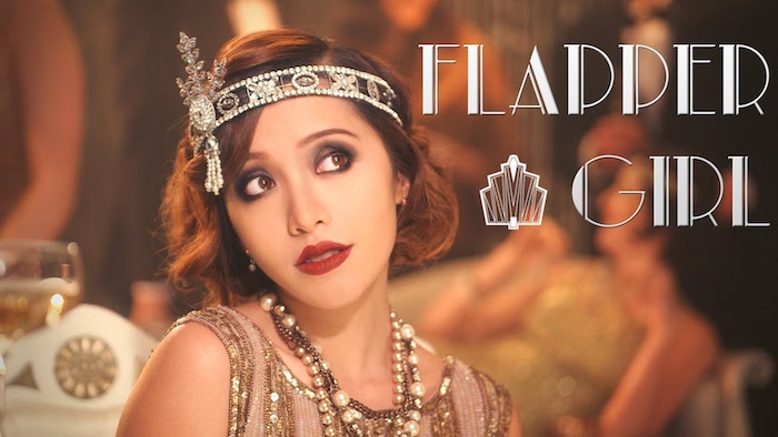ornamental diamante flapper headband, worn by a young woman, with 1920s make up and hairstyle, and several necklaces, great gatsby costumes
