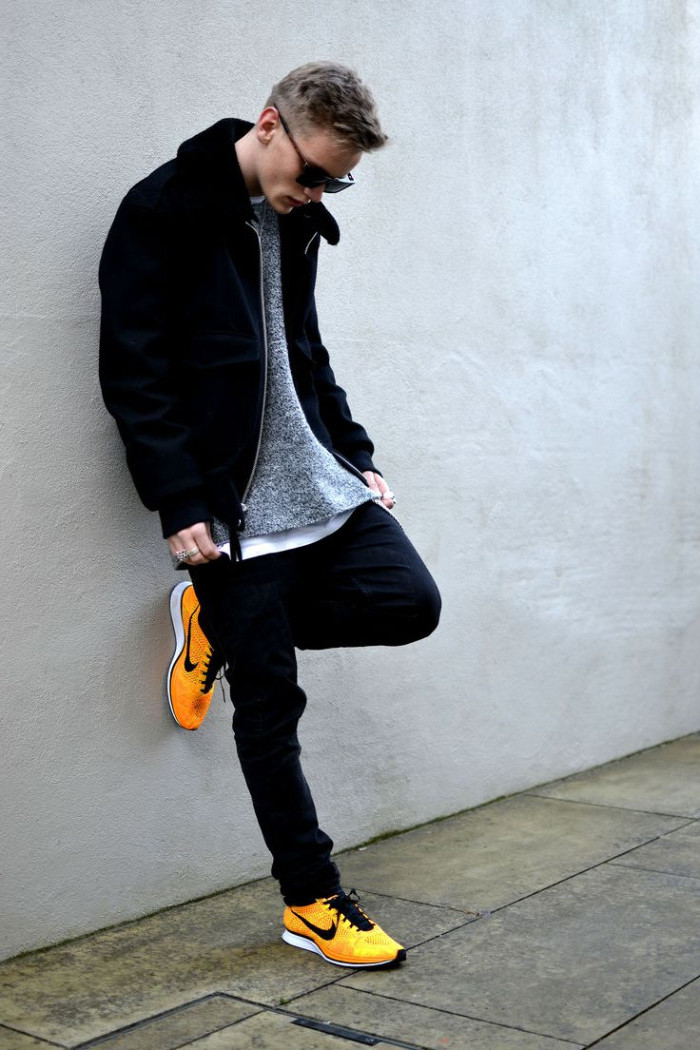 contrasting yellow sneakers, vintage nike shoes, combined with dark jeans, white t-shirt and pale grey jumper, and a black zip-up jacket, what to wear to a 90s party male