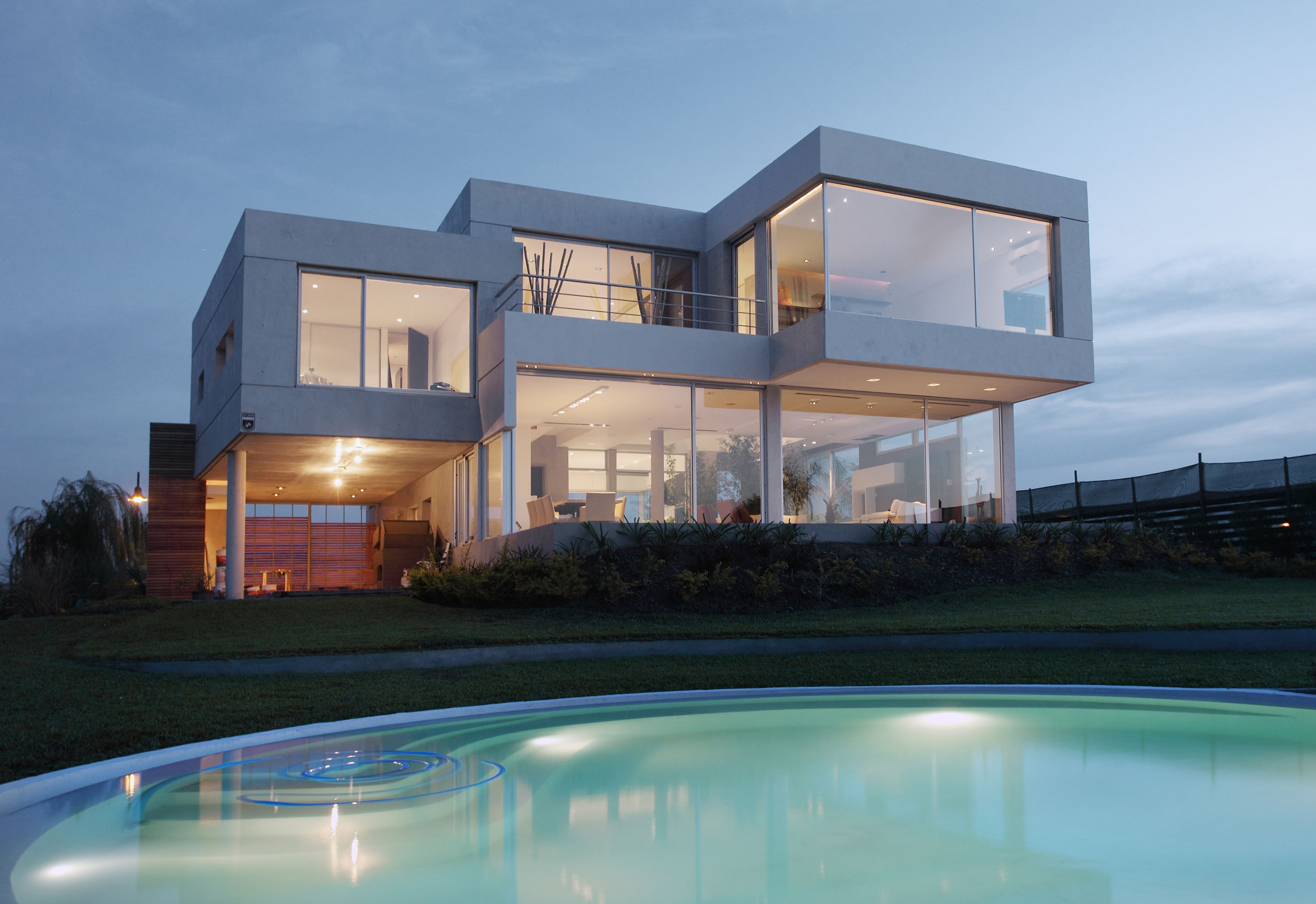 cube-shaped structures, with large windows, and white panelling, forming a house, postmodern architecture, near a blue swimming pool
