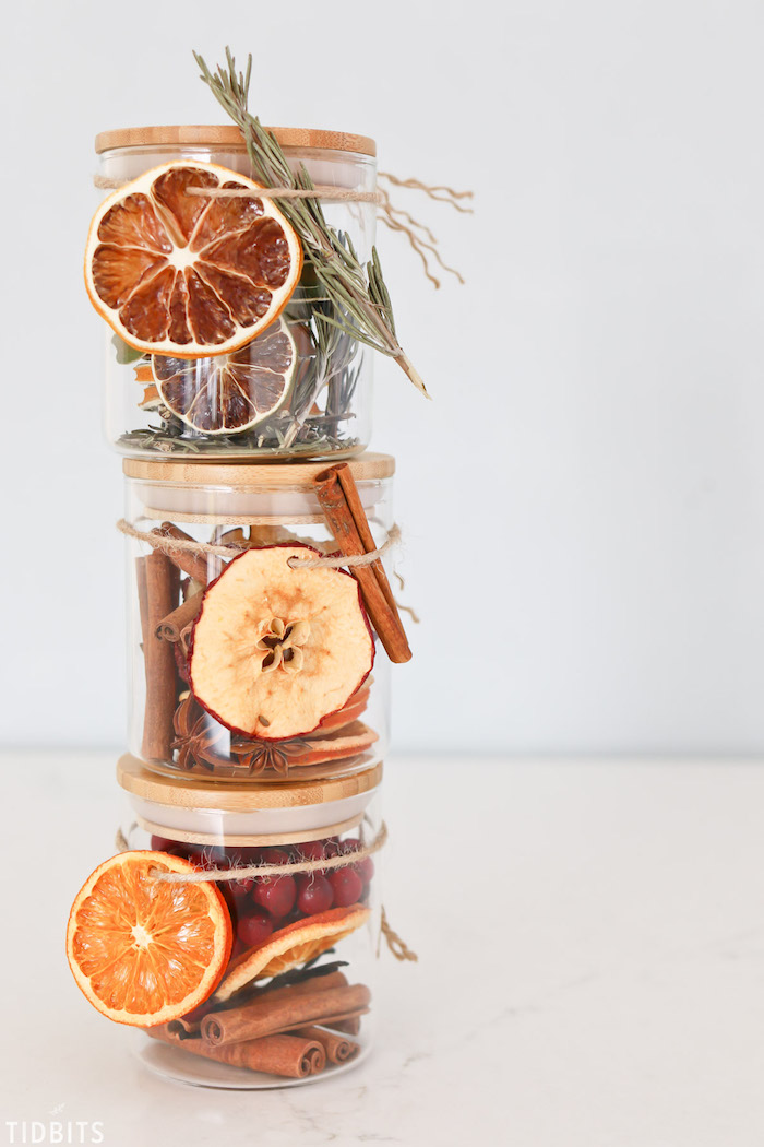 three different types of potpourri in glass jars, stacked one on top of the other, diy christmas gifts, white background