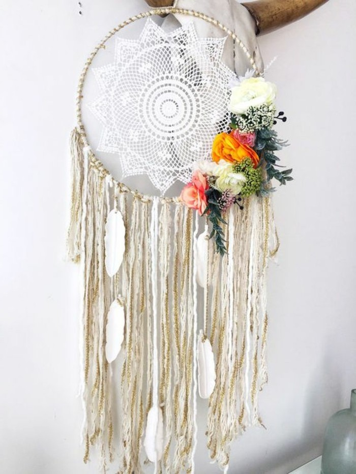 boho-style dreamcatcher, white crochet lace doily, and cream tassels, decorated with white feather ornaments, big dream catchers, pale yellow and orange, green and pink flowers