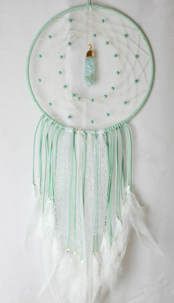 light turquoise dreamcatcher, decorated with white feathers, turquoise beads, and a light blue crystal, large dream catcher