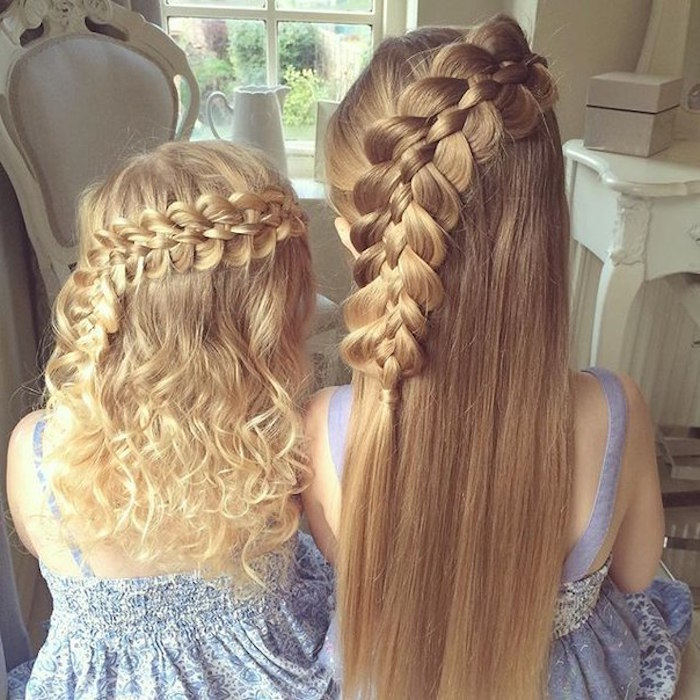 teenage girl with smooth, long blonde hair, and a small child with curly blonde locks, wearing similar side-braided hairdos, seen from the back