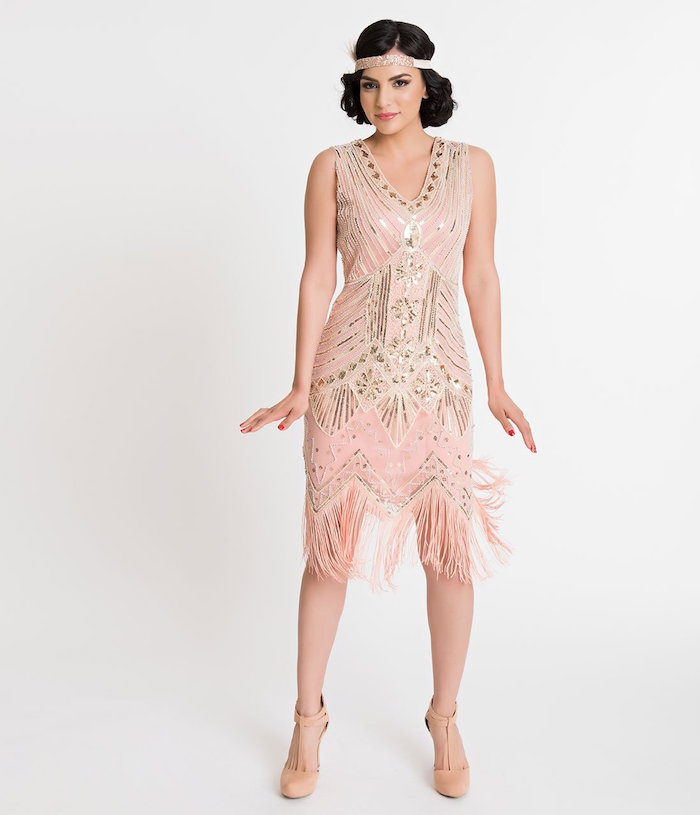 nude pink gatsby dress, featuring shiny silver embroidery, with art deco motifs, on a dark-haired young woman, wearing matching nude pink t-bar shoes