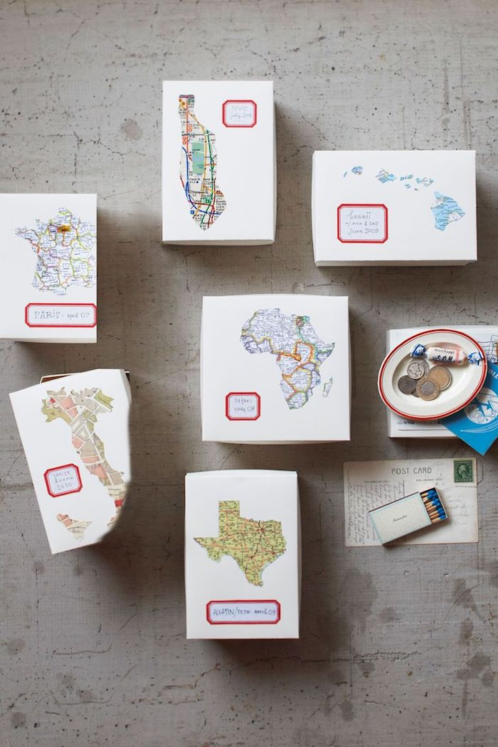 white carton boxes, personalised with maps of different countries and states, diy gifts for friends, arranged on grey surface