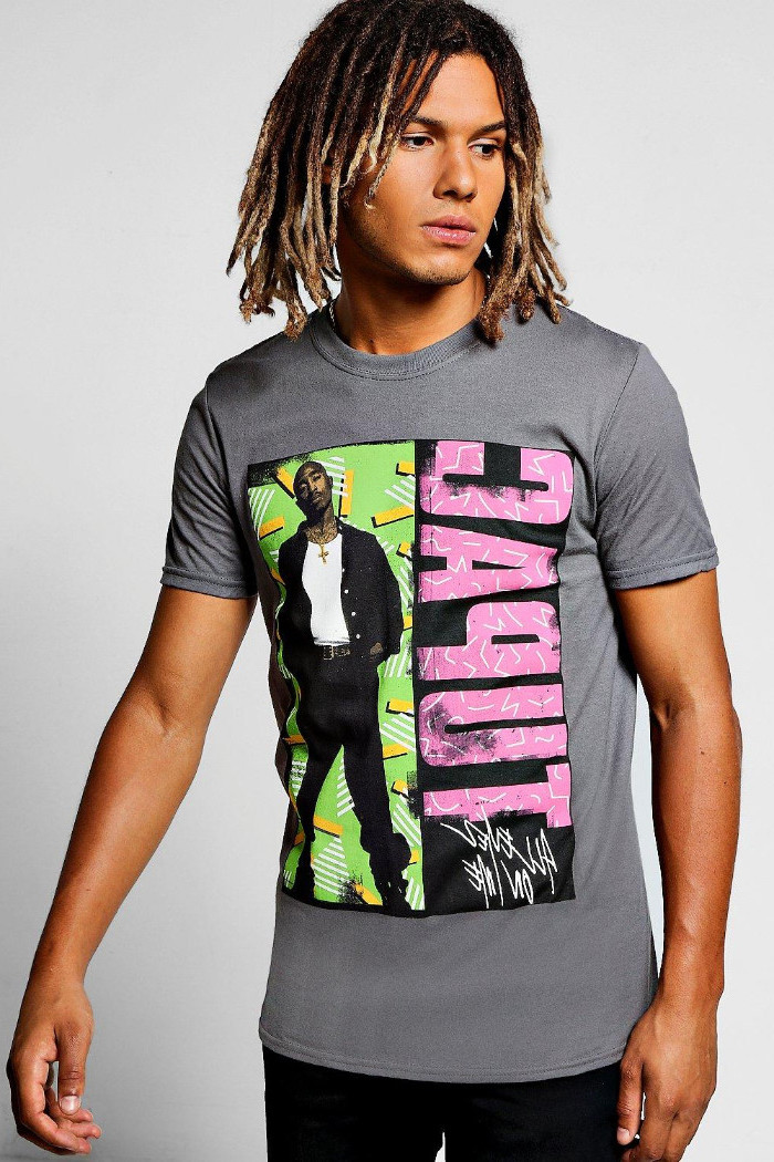 90s clothes mens, grey tupac t-shirt, with pink and black, green and yellow print, on a young man, with shoulder length, ombre effect dreadlocks